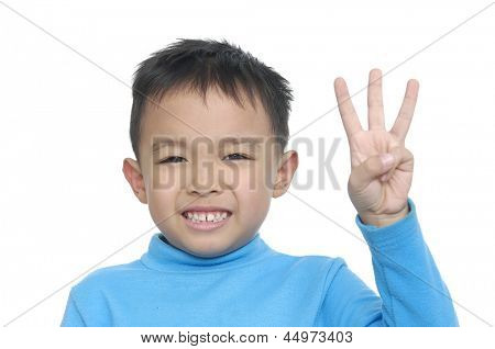 Cute boy and showing three finger isolated on a white background