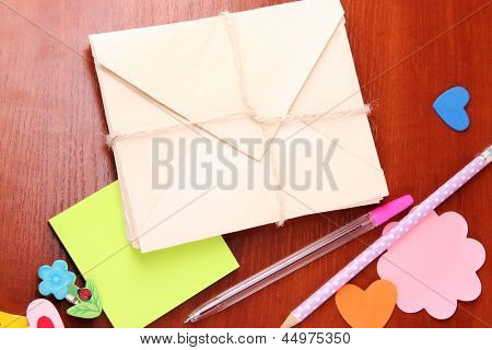 Writing letter of congratulations to Happy Birthday on wooden table close-up