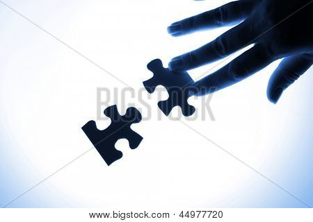 puzzle piece coming down into its place