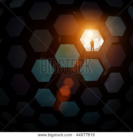 Silhouette of businessman standing in color background