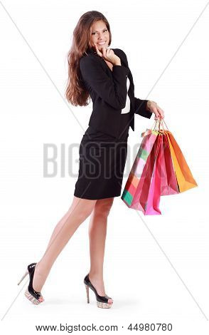 Smiling Woman Holds Bags With Purchases Isolated On White Background.