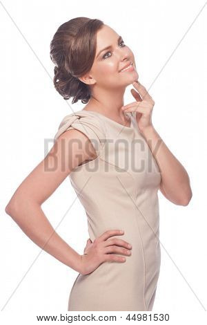 Portrait of  pensive young woman looking up and smiling, over white background