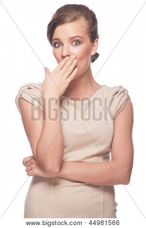 Portrait of surprised young beautiful woman covering her mouth by hand. Isolated on white background