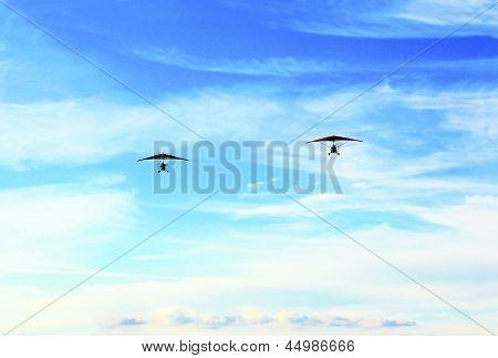 Two hang-glider.