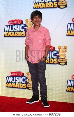 LOS ANGELES - APR 27:  Karan Brar arrives at the Radio Disney Music Awards 2013 at the Nokia Theater on April 27, 2013 in Los Angeles, CA
