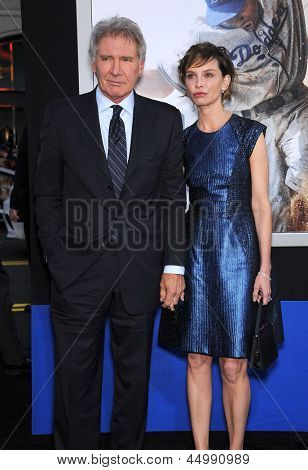 LOS ANGELES - APR 09:  Harrison Ford & Calista Flockhart arrives to the '42' Hollywood Premiere  on April 09, 2013 in Hollywood, CA