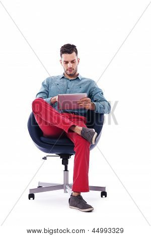 Trendy and young man using digital tablet