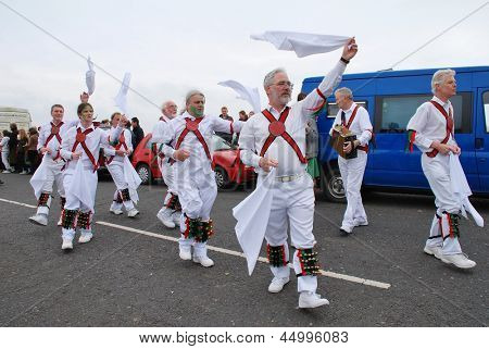 HASTINGS, ENGLAND - MAY 7: Morris dancers perform during a parade on the West Hill at the annual, May Day,  Jack In The Green festival on May 7, 2012 in Hastings, East Sussex.