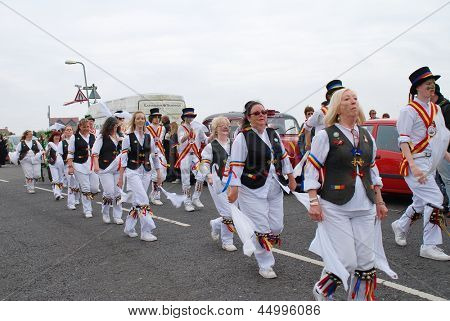 HASTINGS, ENGLAND - MAY 7: Morris dancers perform during a parade on the West Hill at the annual Jack In The Green festival on May 7, 2012 in Hastings, Sussex. The event marks the UK May Day holiday.