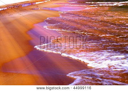 Colorful Patterns Of Sunlight At Shoreline