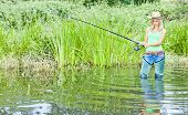 foto of fisherwomen  - woman fishing in pond - JPG