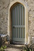 Wooden Doorway In Stone Wall