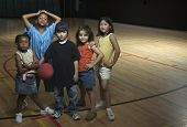 picture of pompous  - Portrait of group of children with basketball - JPG