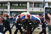 LONDON - UK, APRIL 17: Baroness Thatcher's coffin is carried on a gun carriage on its way to St Paul