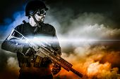 stock photo of rifle  - assault soldier with rifle on apocalyptic clouds - JPG