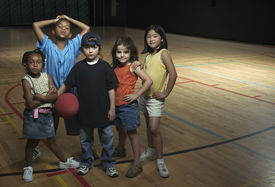 stock photo of pompous  - Portrait of group of children with basketball - JPG