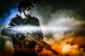 foto of gunshot  - assault soldier with rifle on apocalyptic clouds - JPG