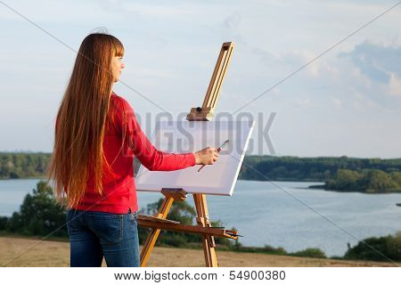 Artist Painting An lake Landscape