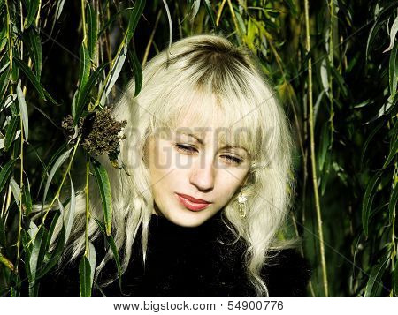 Pretty Blonde In A Green Willow Thickets.