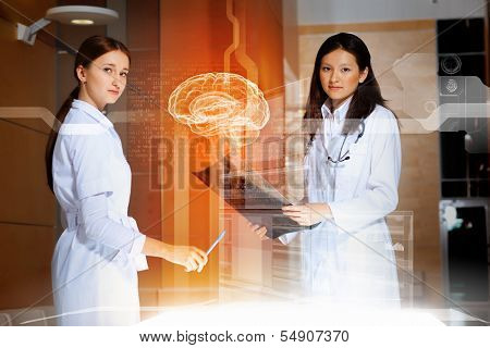 Image of two women doctors examining results