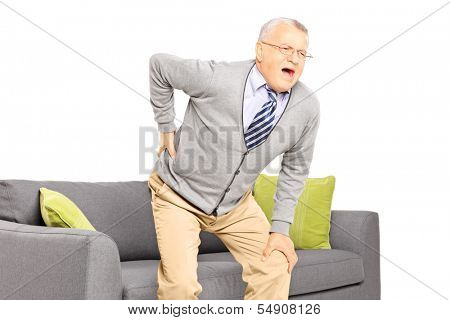 Senior man suffering from back pain isolated on white background