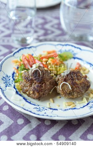 Minced Beef Meat Ball Burger Patties With Some Salad On The Side With Bulgur And Tomatoes