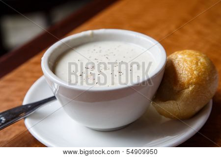 Bowl Of New England Clam Chowder And A Yeast Roll
