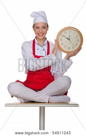 Smiling Chef Holding A Clock