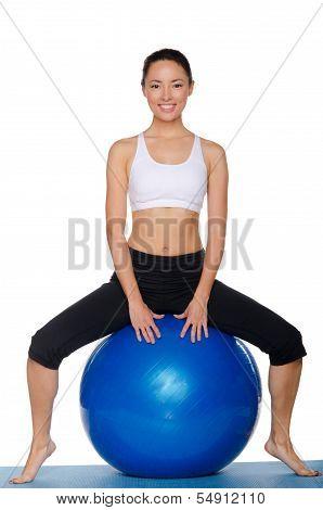 Asian  Sitting On Blue Ball