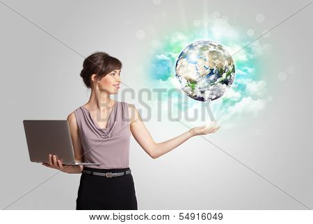 Young business woman with earth and cloud concept(NASA imagery)