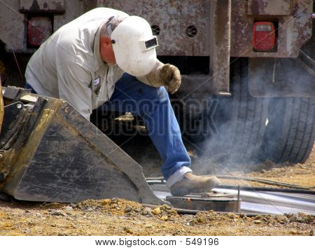 Welder Working At Oil Rig Site