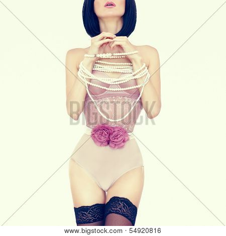 sensual portrait of slim woman in a romantic lingerie