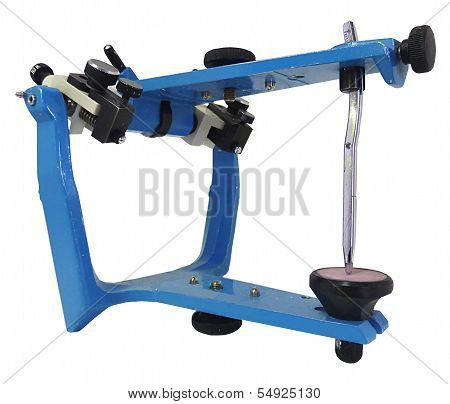 Blue metallic articulator used in dentistry