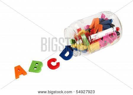 Colorful Symbols Of Alphabet In Glass Can. Education Concept. Isolated On White