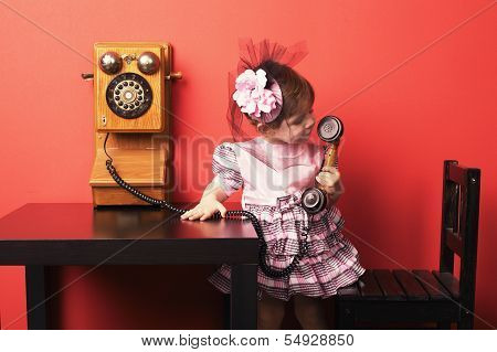 little girl with vintage phone