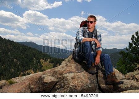 Rock Climber On Top Of A Mountain