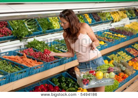 Shopping Series - Young Woman Buying Vegetable