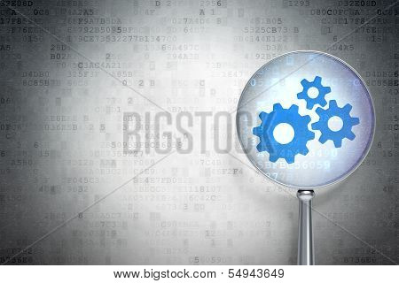 Marketing concept:  Gears with optical glass on digital background