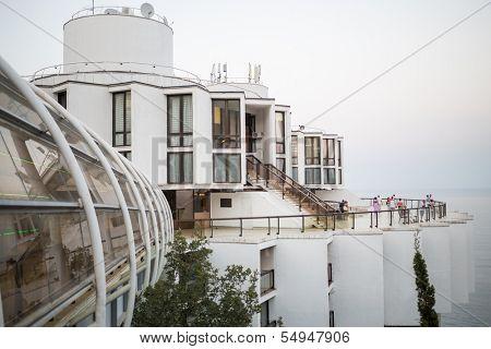 YALTA - AUG 29: Beautiful building of Sanatorium Kurpaty with people on a survey platform on August 29, 2013 in Yalta, Ukraine.