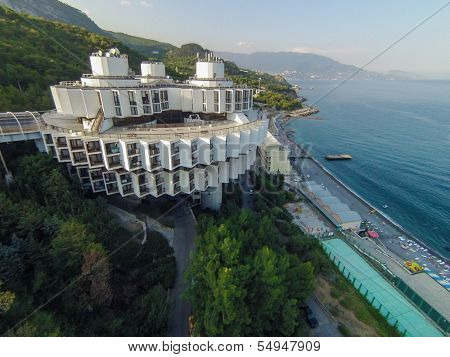 YALTA - AUG 29: Beautiful building of Sanatorium Kurpaty against sea and mountain on August 29, 2013 in Yalta, Ukraine. View from unmanned quadrocopter.