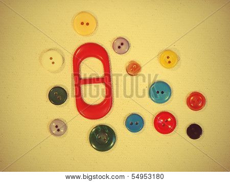 Set Of Buttons On Yellow Fabric Suitable As Background.