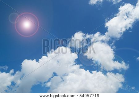 Sky And White Billows With Lens Flare