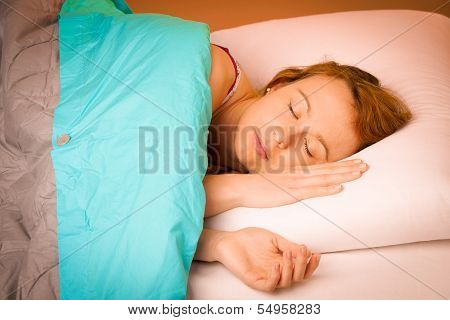 Woman Iling On Pillow In Bed, Covered With Blanket