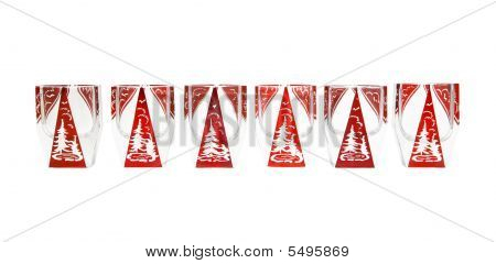 Row Of Beautiful Red Crystal Liqueur Glasses With Cut Fir-tree Isolated