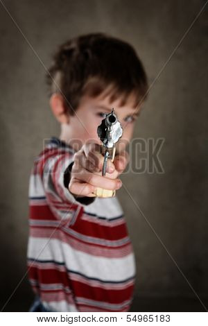 Boy aiming toy gun, shallow focus