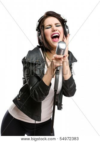 Half-length portrait of rock singer with earphones wearing leather jacket and keeping static microphone, isolated on white. Concept of rock music and rave
