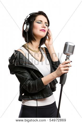 Half-length portrait of rock musician with earphones wearing leather jacket and keeping static microphone, isolated on white. Concept of rock music and rave