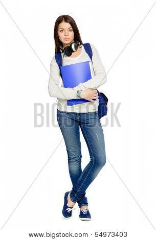 Full-length portrait of teenager with folder, rucksack and earphones, isolated on white