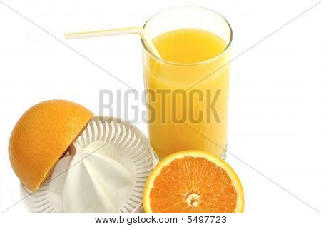 Juicer With Slices Of  Orange And Glass Of  Fresh Juice.