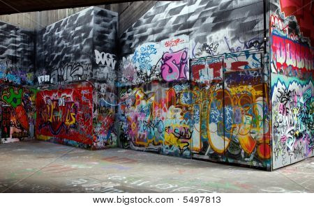 Gray walls painted with bright colorful graffiti